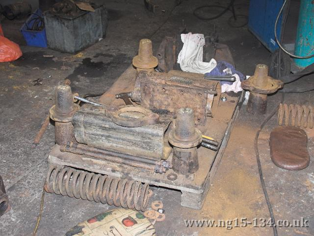 The dismantled pony truck side compensation units showing the internal springs now removed.